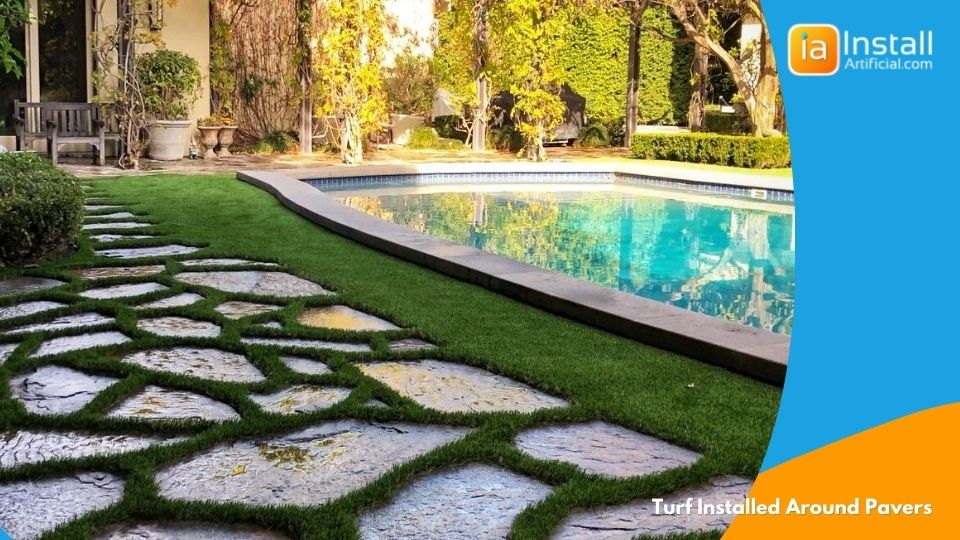 artificial turf installation around concrete pavers during backyard grass project