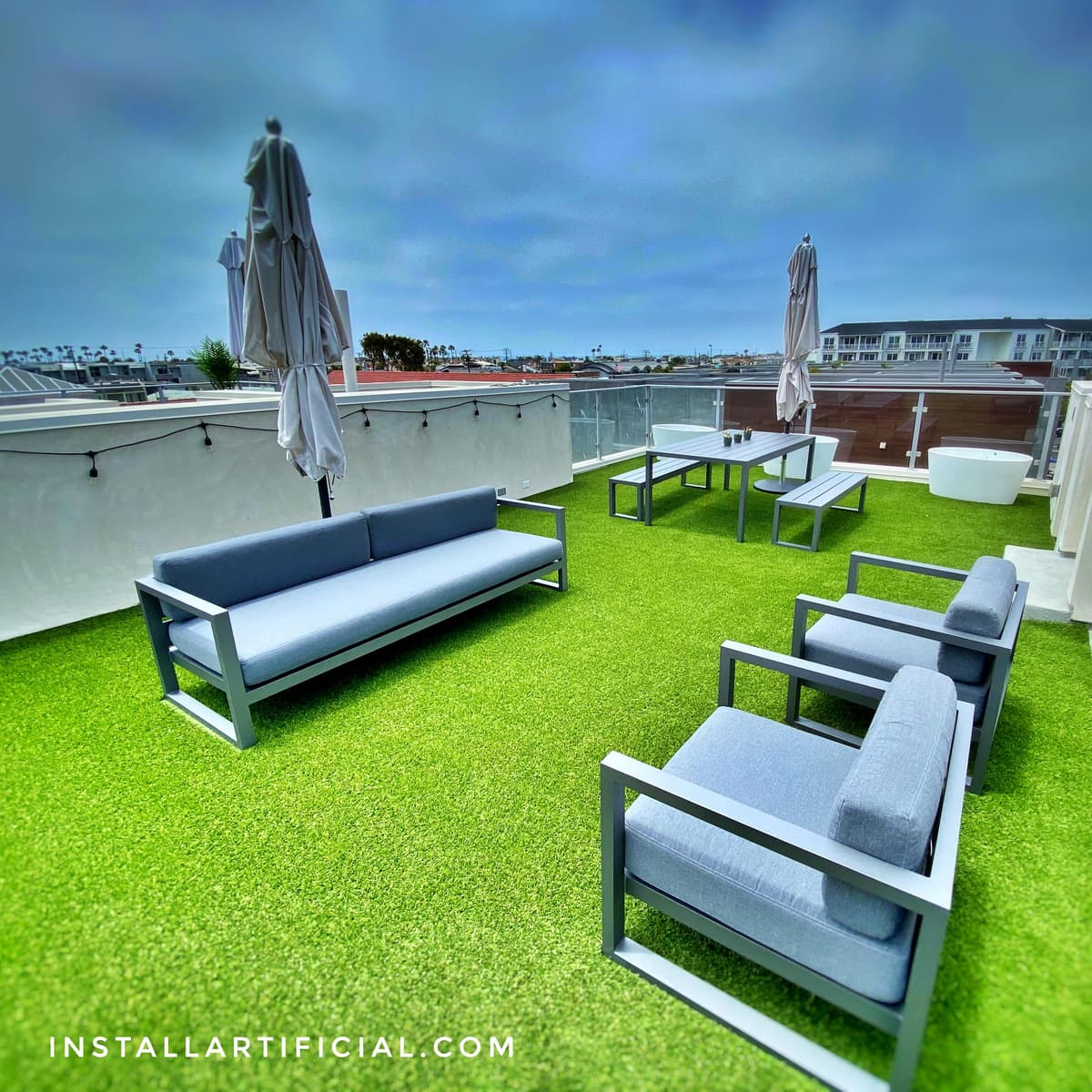 Converted rooftop into patio with artificial grass, residential