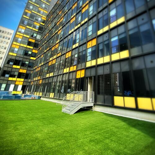 commercial rooftop converted into patio with synthetic turf