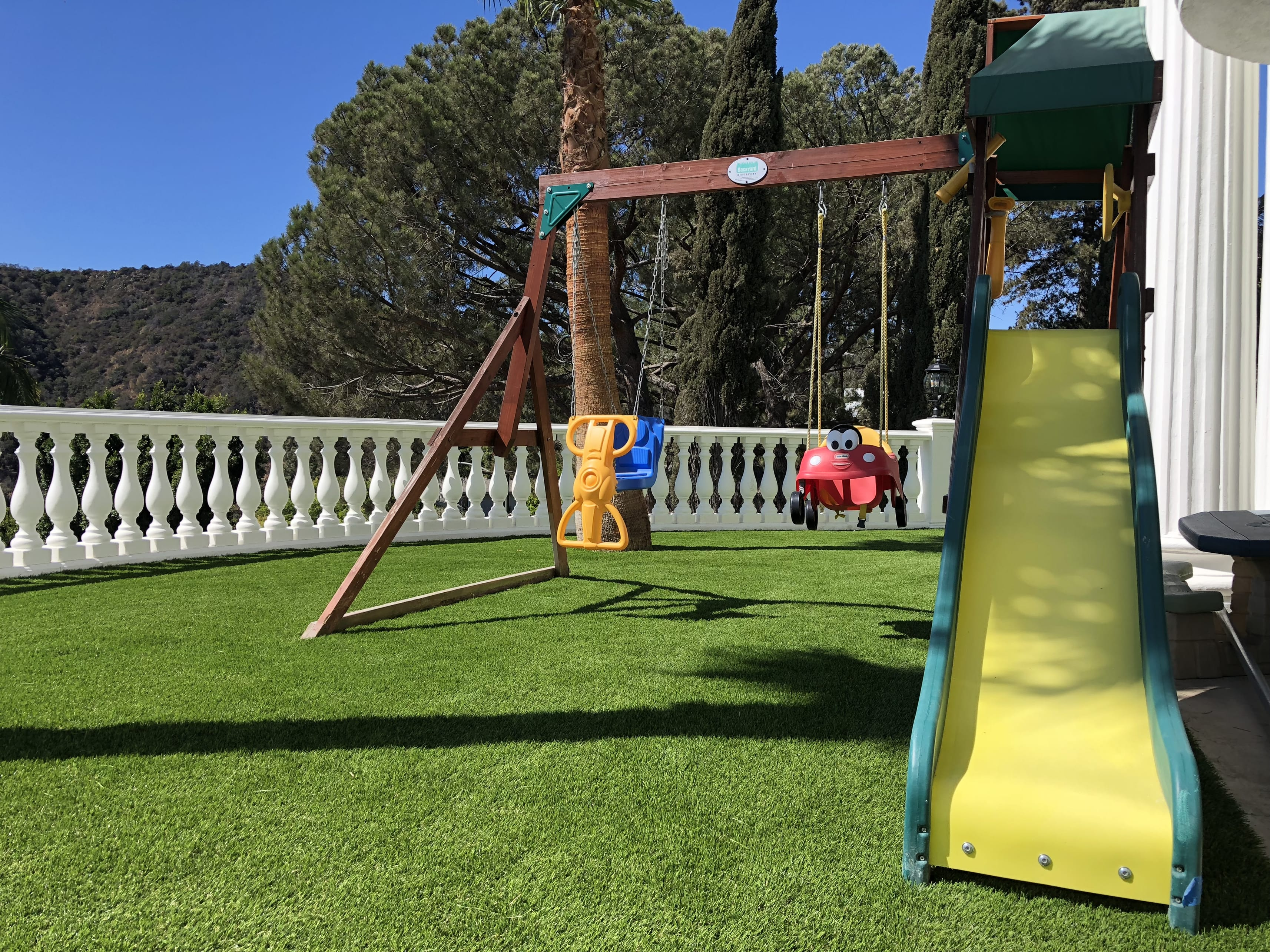 residential swing set artificial turf