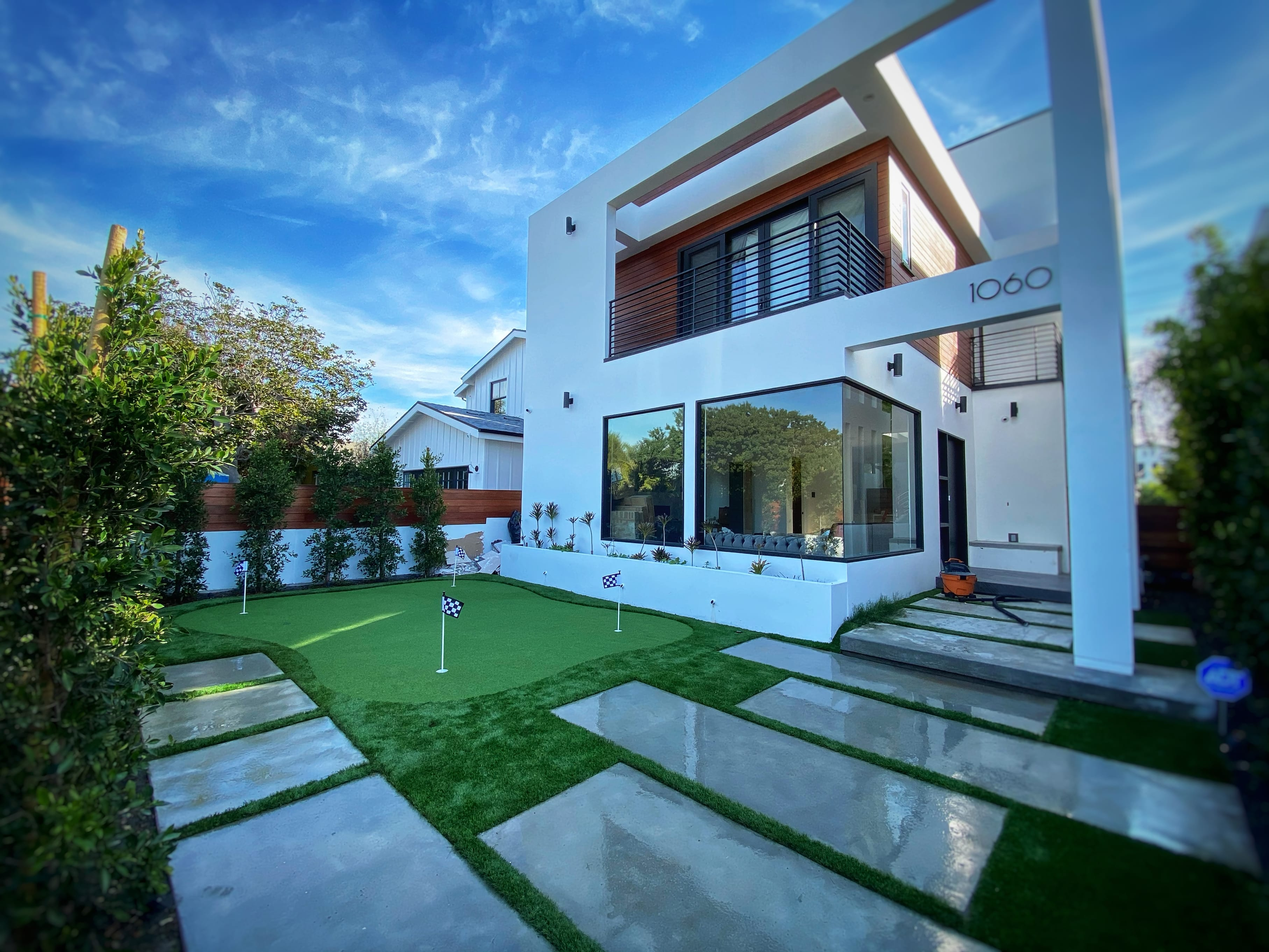 modern house with a putting green golf court