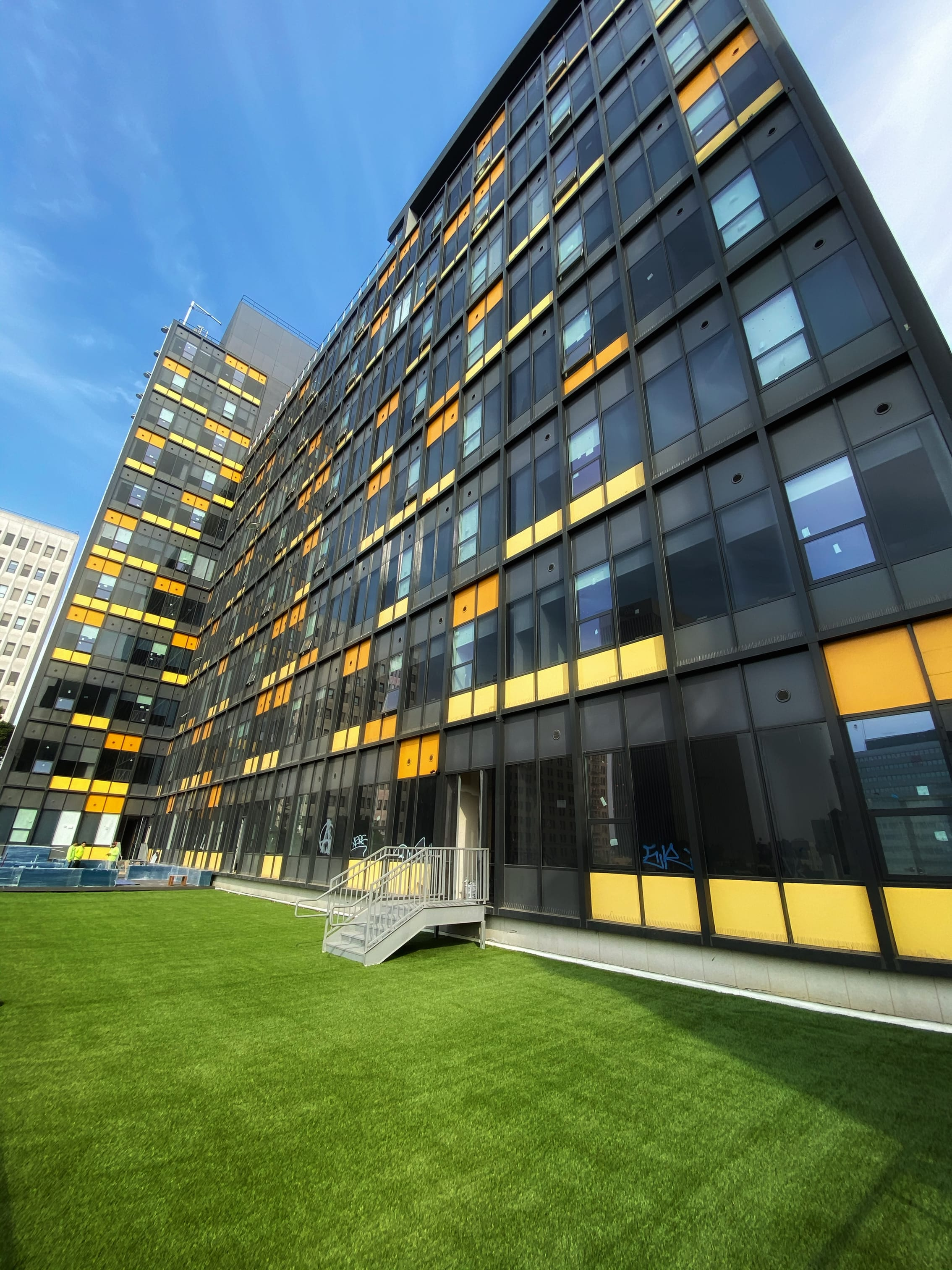 commercial building living space with artificial turf