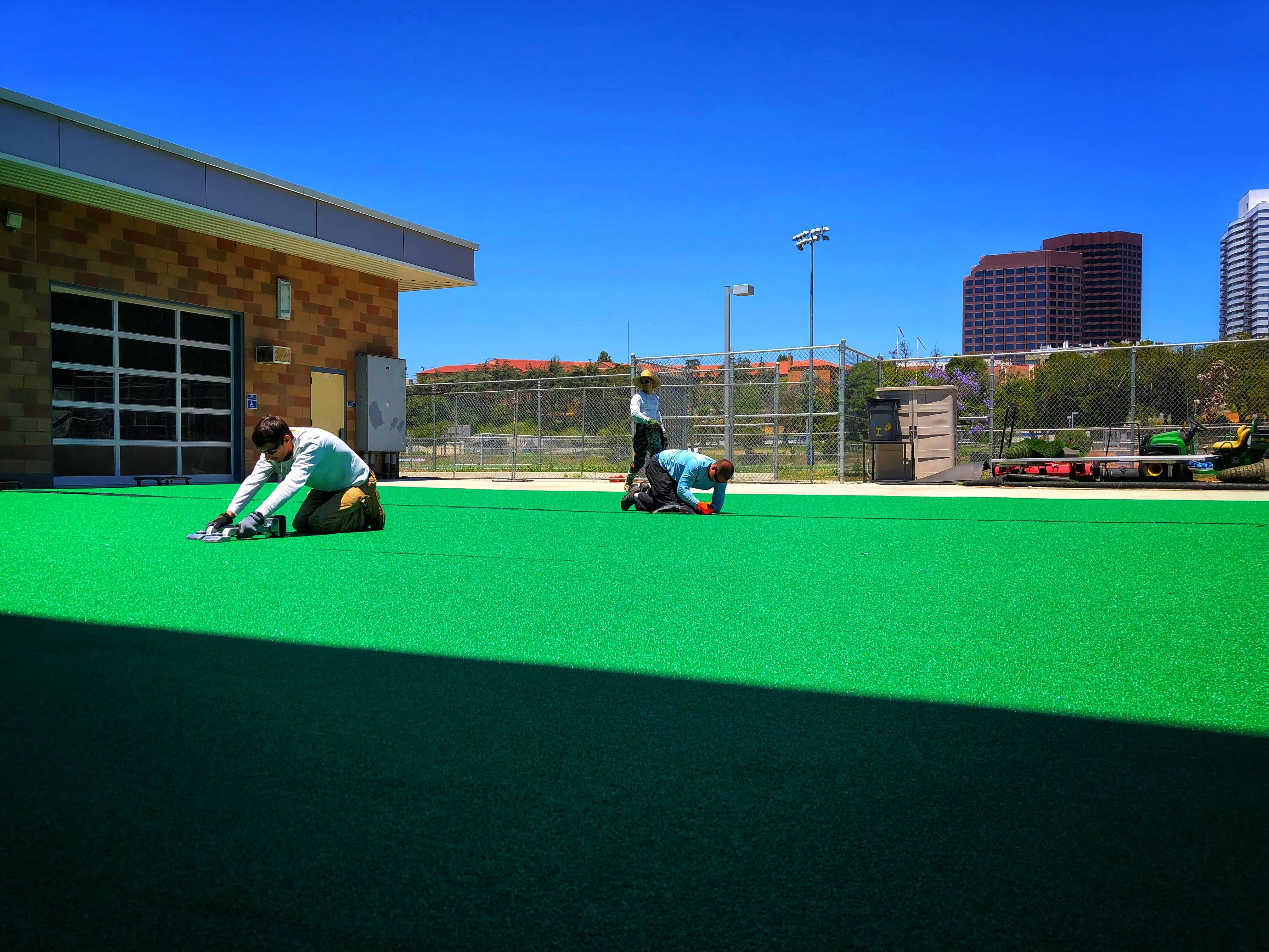 installers at work sports turf